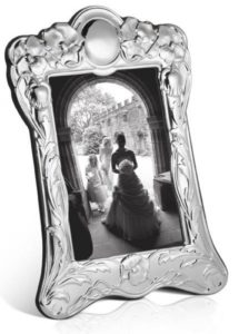 solid silver picture frame with wedding phot inside it